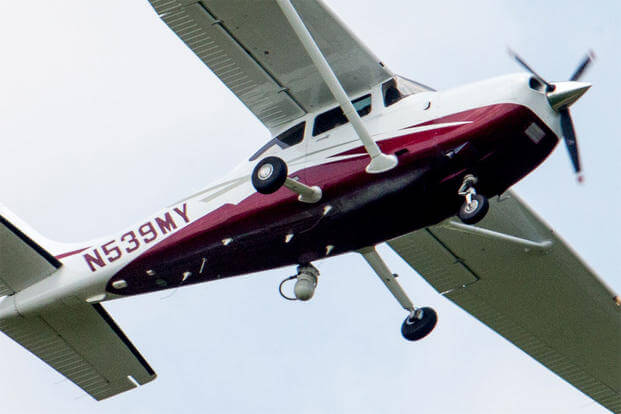 In this photo taken May 26, 2015, a small plane flies near Manassas Regional Airport in Manassas, Va. The plane is among a fleet of surveillance aircraft by the FBI. (AP Photo/Andrew Harnik)