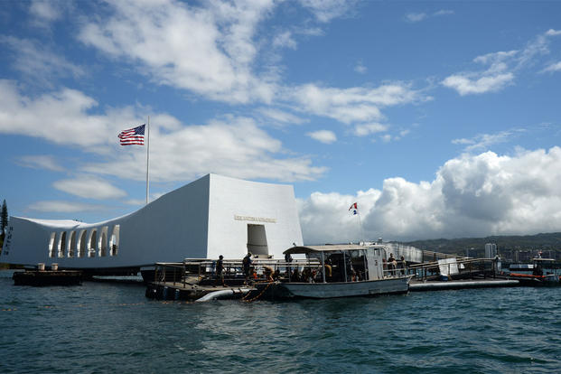 In this Wednesday, June 3, 2015, photo provided by the U.S. Navy, sailors work to repair the floating dock next to the USS Arizona Memorial in Pearl Harbor, Hawaii. (Mass Communication Specialist 2nd Class Laurie Dexter/U.S. Navy via AP)