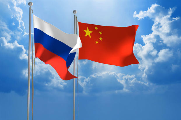 Chinese and Russian flags waving.