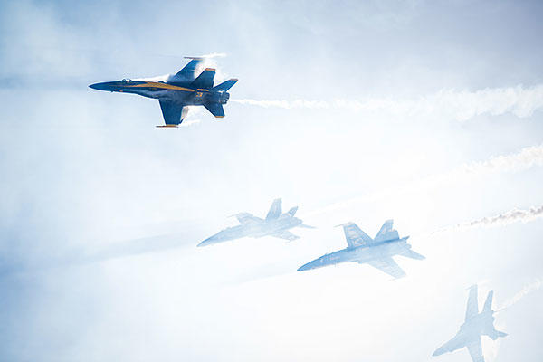 U.S. Navy flight demonstration squadron the Blue Angels perform a high-speed diamond break-away maneuver at the Marine Corps Air Station Miramar Air Show. (U.S. Navy/MC2 Nolan Kahn)