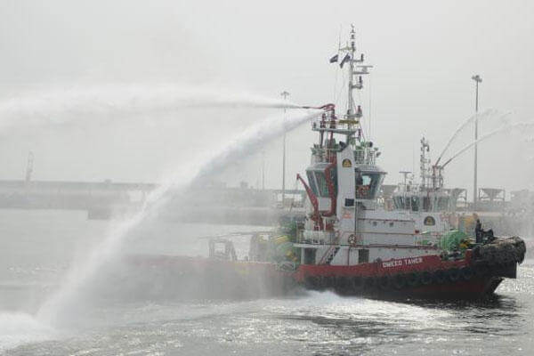 The U.S chartered fire tug the OMEED TAHER sprays water from its hoses during a mass training exercise at Pier 17 at the Port of Shuaiba (SPOD) in Kuwait, Oct. 22, 2009. (U.S. Army photo/ Spc. Monte Swift)