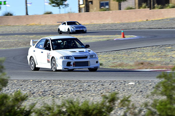 Tech. Sgt. Gabriel, a 432nd Wing/432nd Air Expeditionary Wing MQ-9 Reaper sensor operator, races his Mitsubishi Lancer Evolution at the Spring Mountain Raceway Nov. 1, 2015, in Pahrump, Nevada. (U.S. Air Force/A1C Christian Clausen)