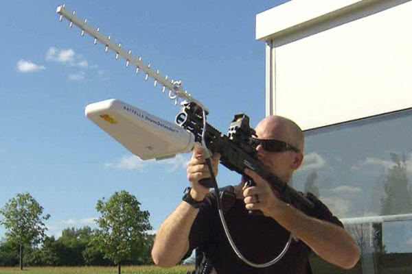 Caption: Battelle's DroneDefender is a shoulder-fired weapon that uses radio waves to cut the link between the drone and its controller. (Photo courtesy Battelle)
