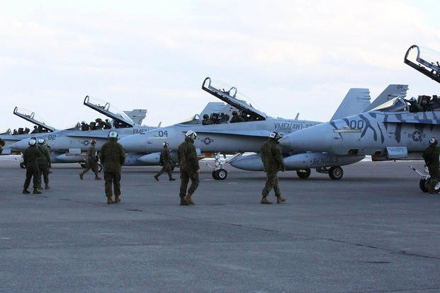 Maintainers with Marine All-Weather Fighter Attack Squadron 224 approach F/A-18D Hornets that arrived from Marine Corps Air Station Iwakuni to Chitose Air Base in Hokkaido, Japan, Jan. 12, 2016. (Photo: Cpl. Jessica Quezada)