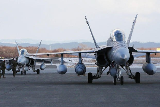 Two F/A-18D Hornets with Marine All-Weather Fighter Attack Squadron 224 taxi down the Chitose Air Base apron after traveling from Marine Corps Air Station Iwakuni, Jan. 12, 2016. (Photo: Cpl. Jessica Quezada)