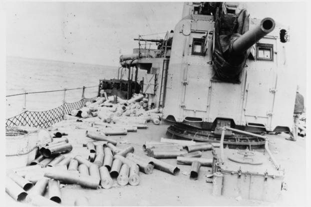 Expended cartridge cases and powder tanks from the USS Hobson's 5/38 guns litter the deck, after firing in support of the Normandy invasion off Utah Beach, 6 June 1944. (U.S. Naval History and Heritage Command Photograph/ Rear Admiral Kenneth Loveland)
