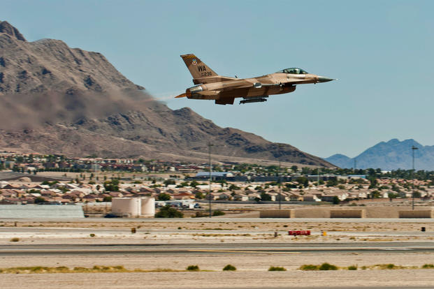 An F-16 Fighting Falcon assigned to the 64th Aggressor Squadron takes off for a training flight Aug. 13, 2013, at Nellis Air Force Base, Nev. (U.S. Air Force photo/Airman 1st Class Joshua Kleinholz)