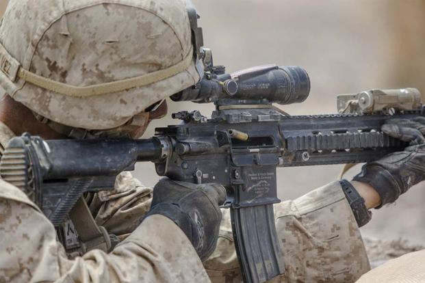 A U.S. Marine fires a M27 infantry automatic rifle at simulated enemies during an Integrated Training Exercise at Marine Corps Air-Ground Combat Center Twentynine Palms, Calif., Aug. 18, 2016 (U.S. Marine Corps/Lance Cpl. Danny Gonzalez)