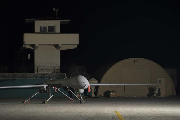 An MQ-1B Predator from the 62nd Expeditionary Reconnaissance Squadron Detachment 1 sits on a ramp, Feb. 3, 2016. (U.S. Air Force photo/Tech. Sgt. Robert Cloys)