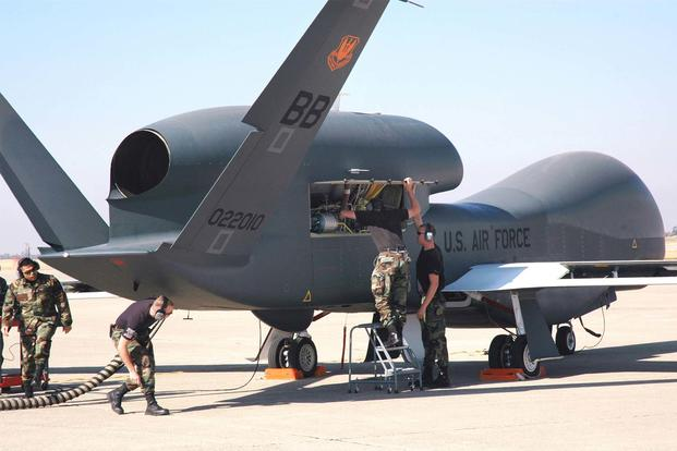 Avionics specialists with the 12th Aircraft Maintenance Unit prepare a Global Hawk Unmanned Aerial Vehicle for a runway taxi test at Beale Air Force Base, Calif. (U.S. Air Force/Stacey Knott)
