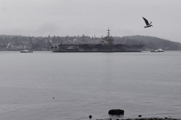 The decommissioned aircraft carrier USS Independence is towed through Sinclair Inlet en route to Brownsville, Texas, for dismantling by International Shipbreaking LTD, March 11, 2017. (U.S. Navy Photo/Mass Communication Specialist 2nd Class Vaughan Dill)