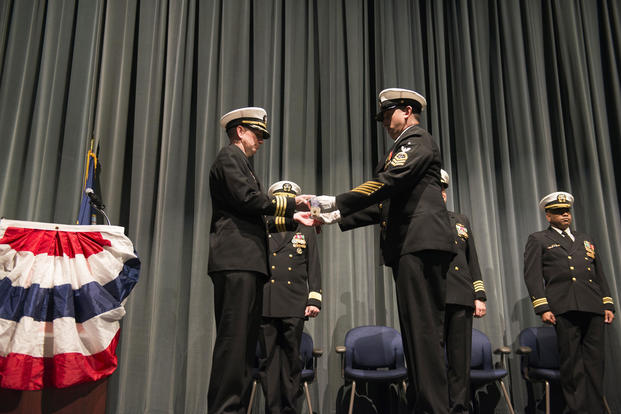 Cmdr. Donald Tenney, left, commanding officer of the USS Albuquerque is presented with Albuquerque's commissioning pennant during a decommissioning ceremony, Feb. 27, 2017. (U.S. Navy/Mass Communication Specialist 1st Class Amanda R. Gray)