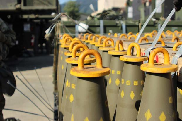 Dozens of 155mm Base Burn Dual Purpose Improved Conventional Munitions rounds wait to be loaded into M109A6 Paladin howitzers, Sept. 20, 2016 at Camp Hovey, South Korea. (Army Photo/Gabriel Jenko)