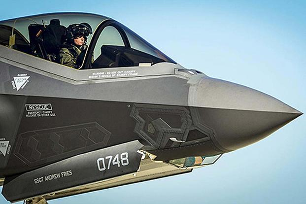A U.S. Air Force pilot waits in the cockpit of an F-35 Lightning II during a hot refuel at Eglin Air Force Base, Fla., on Dec. 12, 2013. (Senior Airman Christopher Callaway/Air Force)