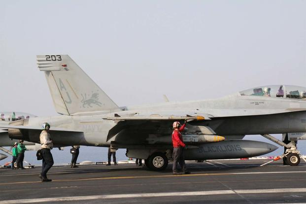 An armed F/A-18F Super Hornet attached to Strike Fighter Squadron 213 prepares to be launched from the deck of the carrier George H.W. Bush May 3 in support of Operation Inherent Resolve. (Miliary.com photo/Hope Hodge Seck)