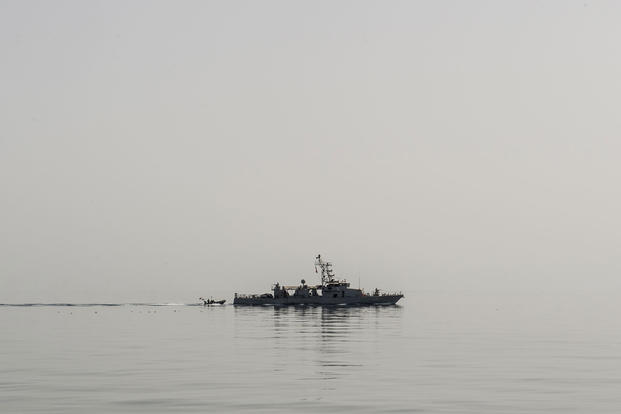 The coastal patrol craft USS Thunderbolt (PC 12) recovers a rigid hull inflatable boat (RHIB) during a trilateral exercise between the U.S., Kuwait and Iraq in the Arabian Gulf, Mar. 15, 2017. (U.S. Navy photo/Petty Officer 2nd Class Corbin Shea)