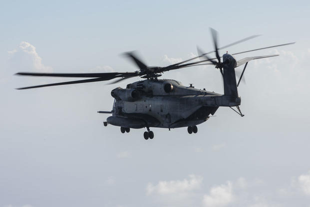 A CH-53 Super Stallion with Marine Heavy Helicopter Squadron 462, 3rd Marine Aircraft Wing, forward conducts a flight off the coast of Okinawa, Japan, July 31, 2017. (U.S. Marine Corps photo/Christian J. Robertson)