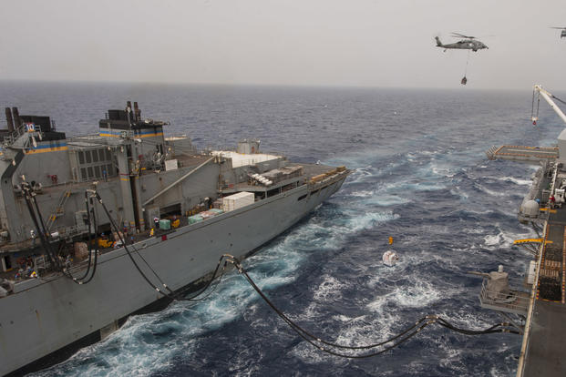 The amphibious assault ship USS Wasp (LHD 1) conducts a replenishment-at-sea alongside the fast combat support ship USNS Supply (T-AOE-6), Sept. 26, 2017. (U.S. Navy photo/Mass Communication Specialist 3rd Class Levingston Lewis)