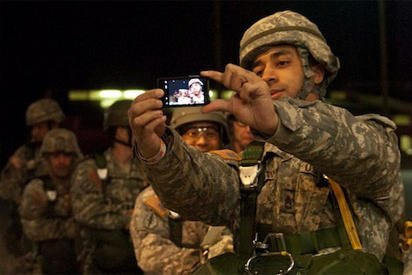 Soldier using smartphone