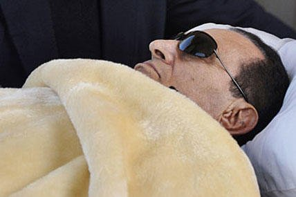 In this Jan. 29 file photo, former Egyptian President Hosni Mubarak is wheeled into court in Cairo, Egypt.