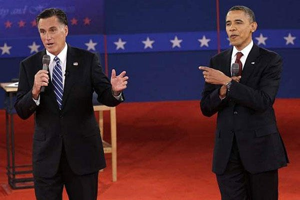 President Barack Obama and Republican presidential nominee Mitt Romney exchange views during the second presidential debate at Hofstra University, Tuesday, Oct. 16, 2012.