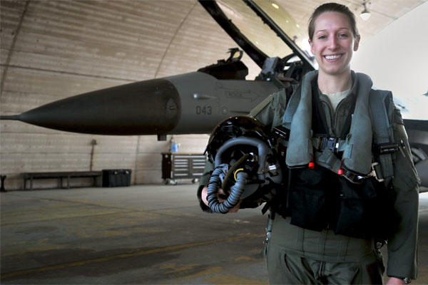 female air force fighter pilot stands alone