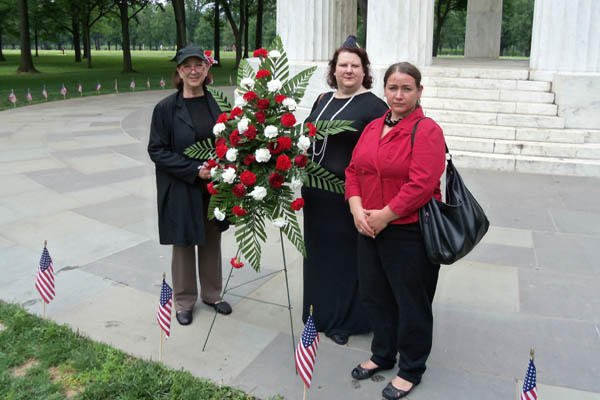 Melinda Tomaino, president of the American Legion auxiliary at the Kenneth H. Nash Post 8 in Washington, D.C., and Post members Barbara Rich and Alicia Fannuth, placed two wreaths at the District of Columbia's World War I Memorial. Richard Sisk photo