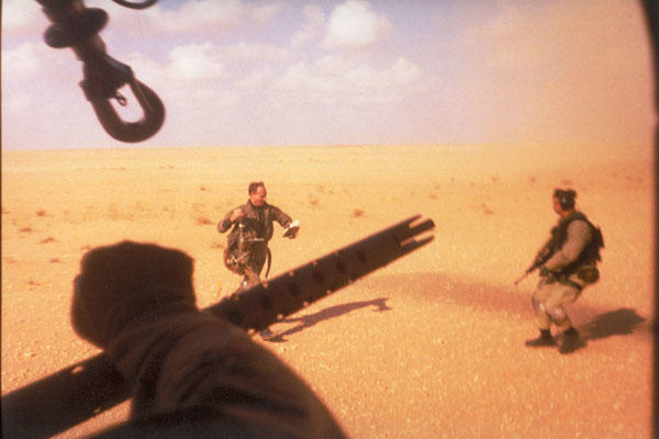 Navy Lt. Devon Jones, left, runs towards the PAVE LOW that rescued him in January 1991 during Operation Desert Storm. The 20th SOS conducted the first combat search and rescue since the Vietnam War.  Air Force photo