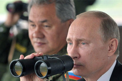 Russian President Vladimir Putin uses binocular as he watches military exercise near Yuzhno-Sakhalinsk, on Sakhalin Island on Tuesday, July 16, 2013. . (AP Photo/RIA Novosti, Alexei Nikolsky, Presidential Press Service, Pool)