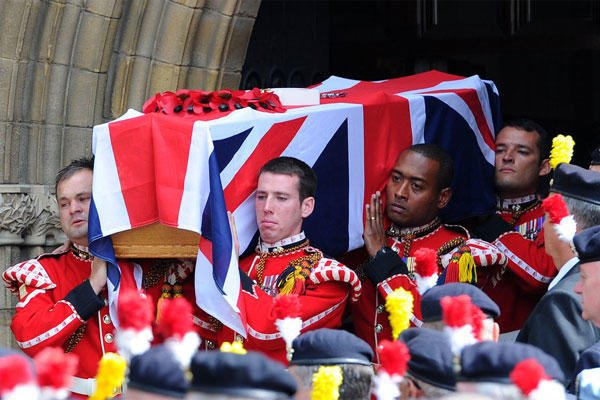 The coffin of murdered Fusilier Lee Rigby is carried by soldiers after his funeral service at Bury Parish church in Greater Manchester, England, Friday July 12, 2013.