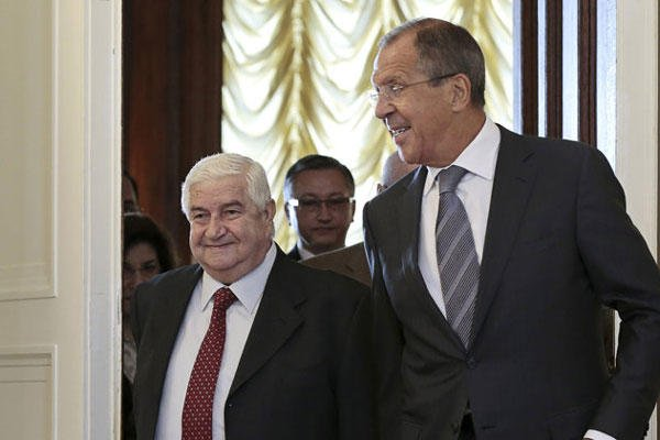 Russian Foreign Minister Sergey Lavrov welcomes his Syrian counterpart Walid al-Moallem, left, prior to talks in Moscow on Monday, Sept. 9, 2013.