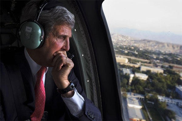 U.S. Secretary of State John Kerry looks out the window en route to the ISAF headquarters after arriving on an unannounced visit in Kabul, Afghanistan, Friday, Oct. 11, 2013.