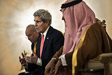U.S. Secretary of State John Kerry, centre, speaks to the media as Saudi Foreign Minister Prince Saud al-Faisal listens, during their meeting in Riyadh, Saudi Arabia, Sunday, Jan. 5, 2014.