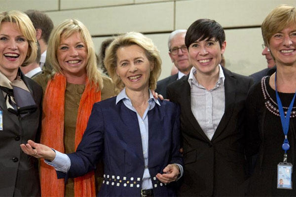 Albania's Mimi Kodheli, Netherland's Jeanine Hennis-Plasschaert, Germany's Ursula von der Leyen, Norway's Ine Marie Eriksen Soreide and Italy's Roberta Pinotti at a meeting of NATO defense ministers on Feb. 26, 2014. (AP Photo/Virginia Mayo)