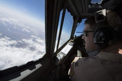 U.S. Air Force Capt. Christopher K. Jordan, 968th Expeditionary Airborne Air Control Squadron E-3/B Sentry aircraft commander, scans the horizon while flying a combat sortie supporting coalition forces during the Afghan Presidential Elections, April 5.