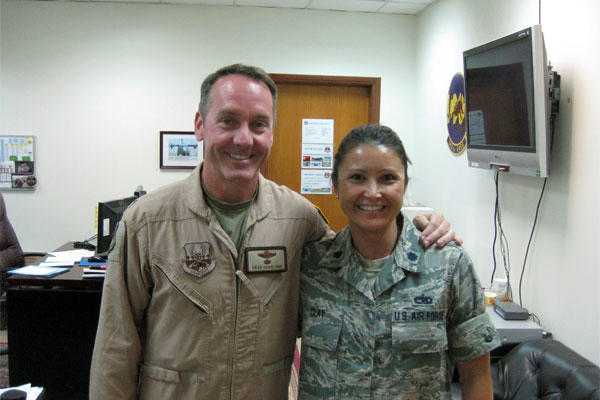 Air Force Col. Brad Hoagland, left, and Air Force Lt. Col. Elizabeth Clay, graduates of the same Ohio high school and of the U.S. Air Force Academy, pose for a photo at the 386th Air Expeditionary Wing in Southwest Asia.