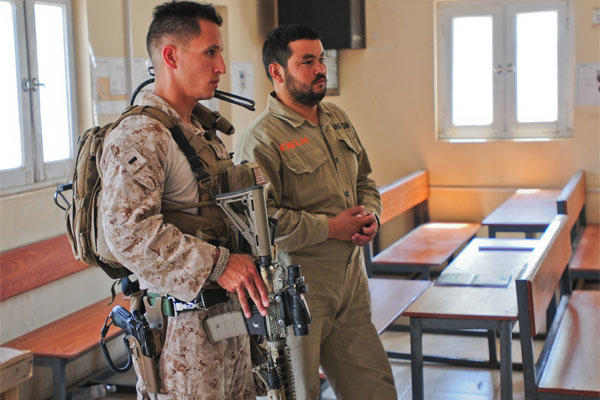 Marine Corps 1st Lt. Manuel Ruiz monitors a heating, ventilation, and air conditioning class conducted by Afghan army engineers at Camp Hero, Afghanistan, May 3, 2014. (U.S. Army photo)