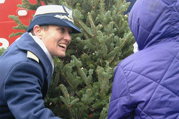 Capt. Amy Cocanour, commander of Coast Guard Sector Lake Michigan, helps present the ceremonial first Christmas tree during the Christmas Ship ceremony at Navy Pier, Dec. 6, 2014. (U.S. Coast Guard photo by Chief Petty Officer Alan Haraf)
