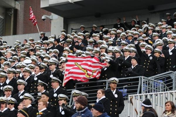 The Naval Academy's Midshipmen hold up the Navy First Jack at the 115th Army-Navy game. (Military.com/Steve Whitman)
