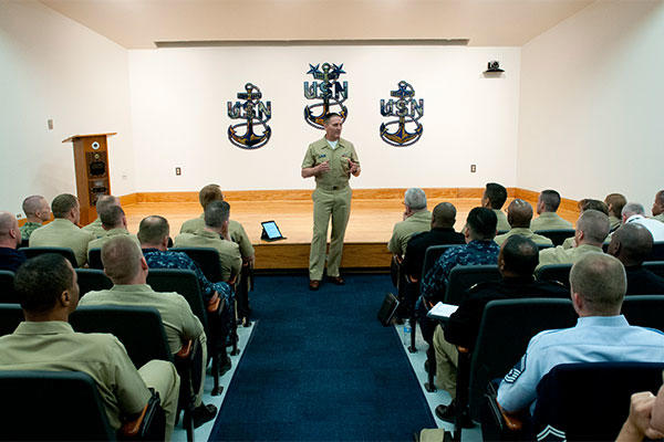 Master Chief Petty Officer of the Navy Mike Stevens speaks with service membersat the Senior Enlisted Academy. (U.S. Navy photo by Mass Communication Specialist 2nd Class Martin L. Carey.)
