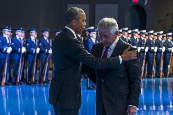 President Barack Obama, left, embraces Secretary of Defense Chuck Hagel during a celebration in honor of Hagel's service, on Wednesday, Jan. 28, 2015, in Fort Myer, Va. Obama. (AP Photo/Evan Vucci)