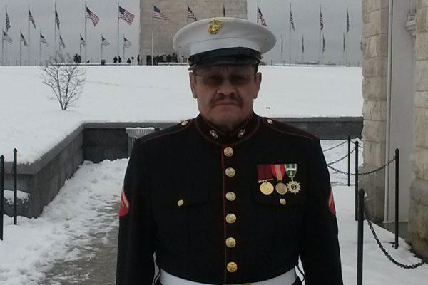 Vietnam veteran former Marine Manuel Valenzuela stands in the snow near the Washington Monument on Jan. 6. Valenzuela expected a large turnout but only a handful of supporters drove in from Chicago to go to the Capitol with him.