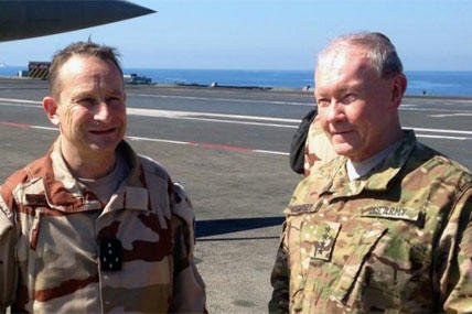 Gen. Martin Dempsey confers with his French counterpart, Gen. Pierre de Villiers, aboard the French aircraft carrier Charles de Gaulle in the Persian Gulf on Sunday, March 8, 2015. (AP Photo/Bob Burns)