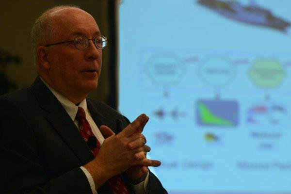 Dr. Jeffery Holland, director of the U.S. Army Engineer Research and Development Center and chief scientist for the U.S. Army Corps of Engineers, speaks during an ERS seminar in Springfield, Va., March 25, 2015.(U.S. Army photo/David Vergun)