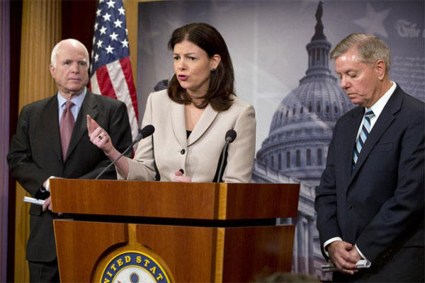 In this Jan. 13, 2015, file photo, Sen. Kelly Ayotte, R-N.H., flanked by Senate Armed Services Committee Chairman Sen. John McCain, R-Ariz., and Sen. Lindsey Graham, R-S.C., speaks during a news conference, Jan. 13, 2015. (AP Photo/Jacquelyn Martin)