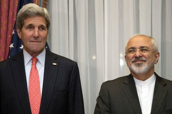 U.S. Secretary of State John Kerry and Iran's Foreign Minister Mohammad Javad Zarif, right, pose before resuming talks over Iran's nuclear program in Lausanne, Switzerland on March 16, 2015. Brian Snyder/AP