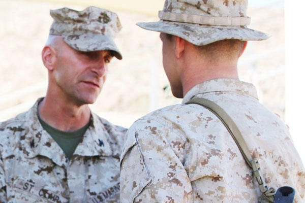 Col. Matthew G. St. Clair, commanding officer of Ground Combat Element Integrated Task Force, presents Lance Cpl. Nicholas J. Cascone with a Navy and Marine Corps Achievement Medal. (U.S. Marine Corps photo: Cpl. Paul S. Martinez)