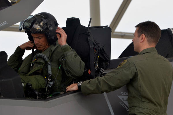 Brig. Gen. Scott Pleus dons his helmet before his first F-35 sortie flight March 18, 2015, at Luke Air Force Base, Ariz. Pleus is the commander of the 56th Fighter Wing.. (U.S. Air Force photo/Senior Airman Devante Williams)