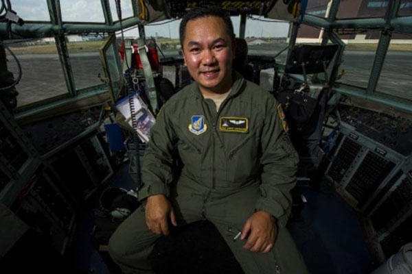 Air Force Staff Sgt. Andre Garrucho, a C-130 Hercules aircraft flight engineer with the 36th Airlift Squadron, Yokota Air Base sits in the flight deck of a C-130 at Clark Air Base, Philippines April 28, 2015. (U.S. Air Force photo/Staff Sgt. Nathan Allen)