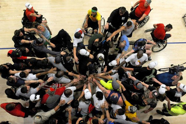 Army trials team tryouts and coaches for the 2015 Department of Defense Warrior Games huddle before basketball practice on Fort Bliss in El Paso, Texas, March 28, 2015.(U.S. Army photo/EJ Hersom)